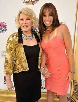 Comedian Joan Rivers and actress Melissa Rivers arrive at the Comedy Central Roast of Joan Rivers held at CBS Studios in Studio City, California. Photo: Getty Images / Getty Images