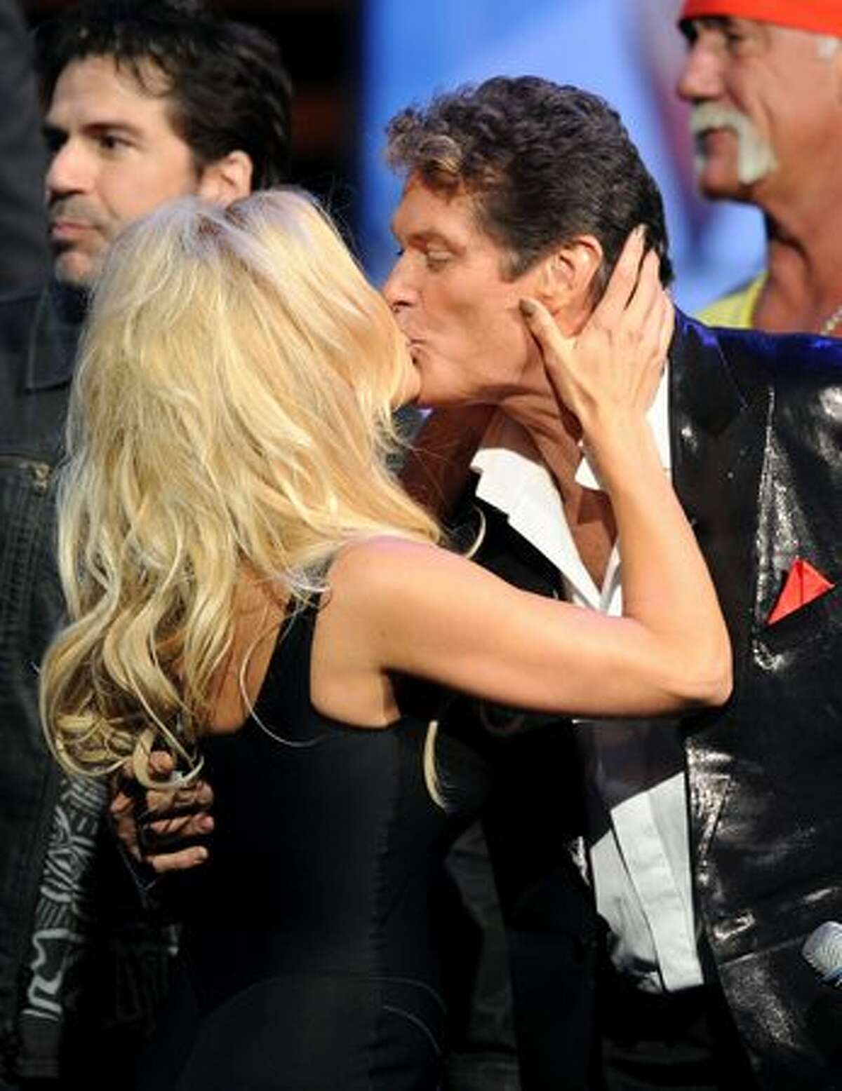 Actor David Hasselhoff (R) kisses actress Pamela Anderson onstage at the Comedy Central Roast of David Hasselhoff held at Sony Pictures Studios in Culver City, California.