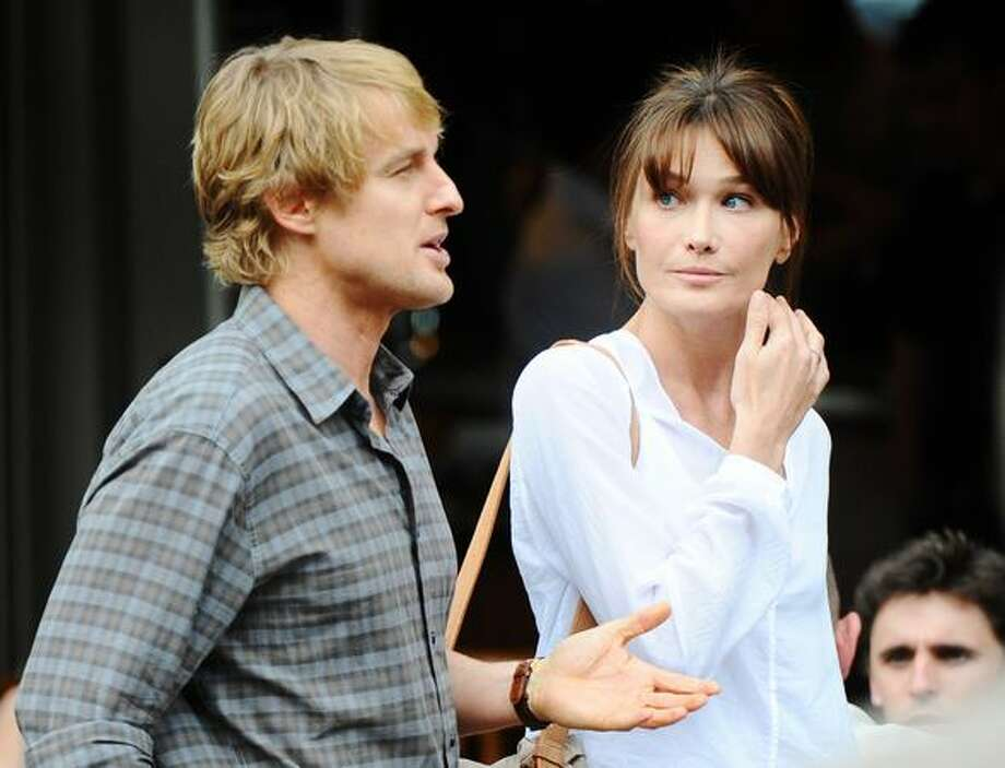 "Former French first lady Carla Bruni-Sarkozy starred in Woody Allen's ""Midnight in Paris"" with Owen Wilson in 2011.  Photo: Getty Images / Getty Images"