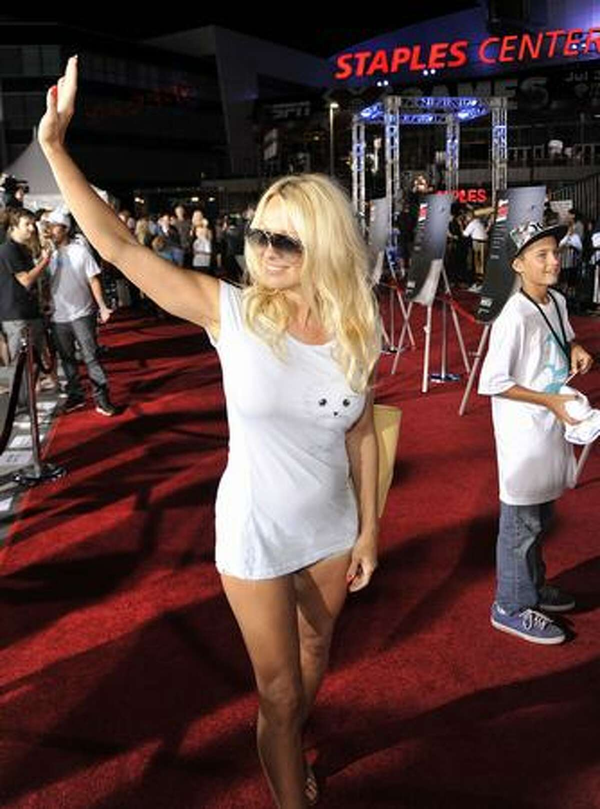 Actress Pamela Anderson arrives at the premiere of ESPN Films and Walt Disney Pictures'