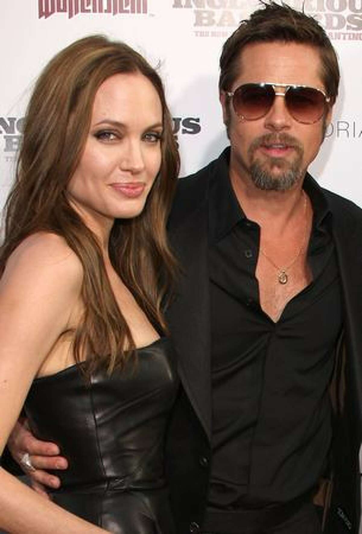 Actress Angelina Jolie (L) and actor Brad Pitt arrive at the premiere of Weinstein Co.'s 'Inglourious Basterds' held at Grauman's Chinese Theatre in Hollywood, California.