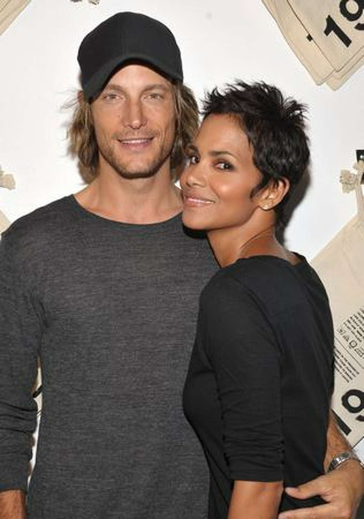 Actress Halle Berry (R) and Gabriel Aubry attend the launch event for Gap's 1969 Jean Shop on Robertson Blvd at their 1969 Jean Shop in West Hollywood, California.