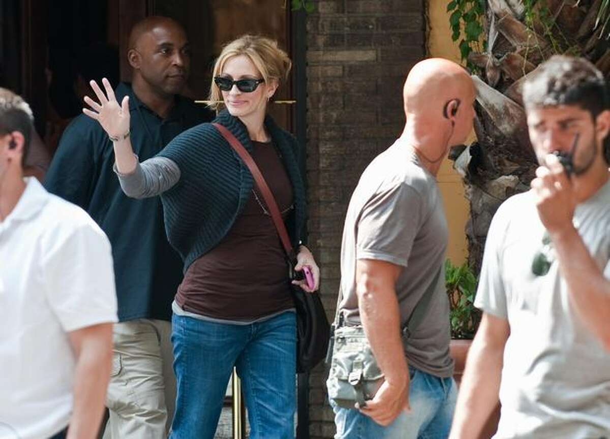 Actress Julia Roberts waves as she leaves the set of the film 'Eat, Pray, Love' in central Rome.