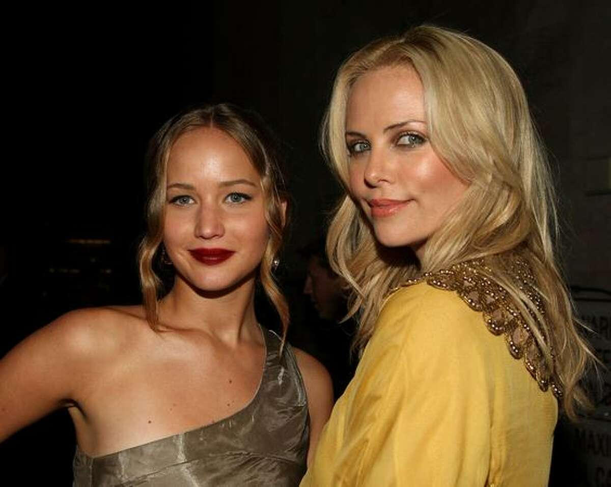 """Actresses Jennifer Lawrence (L) and Charlize Theron attend the """"The Burning Plain"""" film premiere after party at Bond Street Thompson Beverly Hills in Beverly Hills, California."""