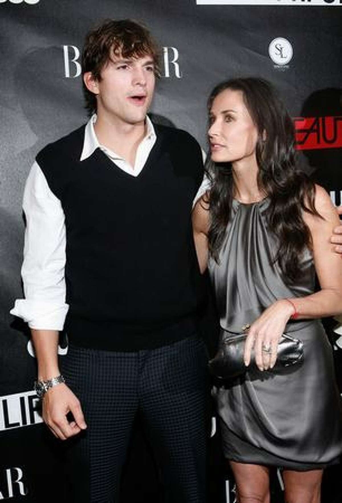 """Actor Ashton Kutcher and actress Demi Moore walk the red carpet during the CW Network celebration of its new series """"The Beautiful Life: TBL"""" at the Simyone Lounge in New York City."""