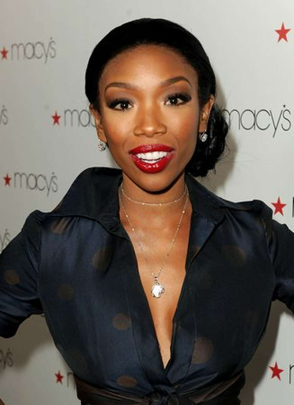 Singer Brandy arrives at Glamorama presented by Macy's Passport at the Orpheum Theatre in Los Angeles, California.