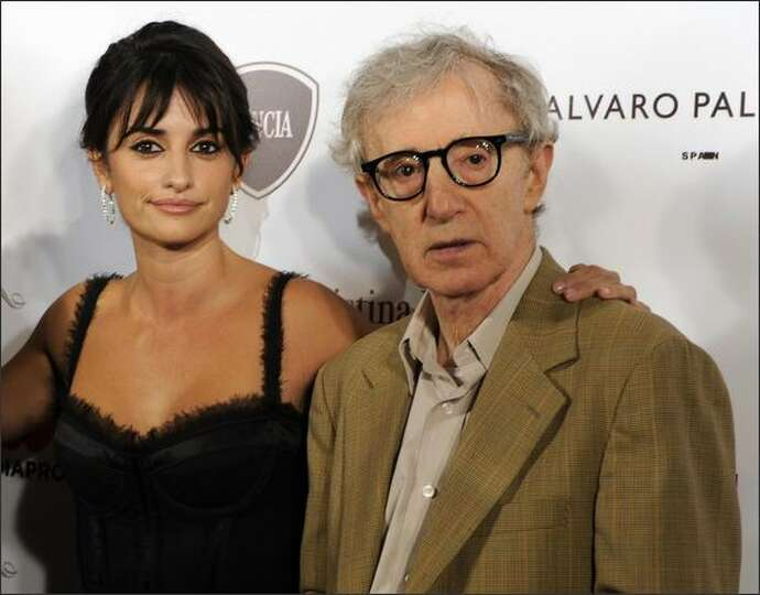 Director Woody Allen and Spanish actress Penelope Cruz pose for photographers before the screening o