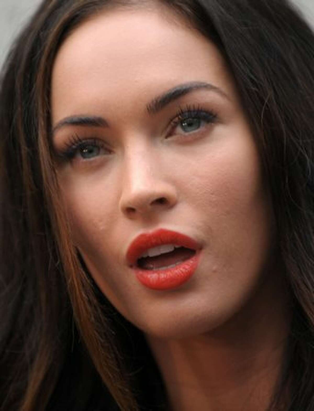 Actress Megan Fox poses as she arrives for the Emporio Armani spring-summer 2011 ready-to-wear collection during the women's fashion week in Milan.