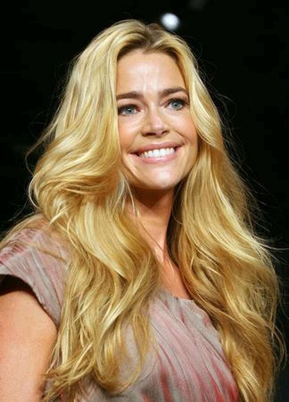 Actress Denise Richards attends Susan G. Komen's 8th annual fashion for the cure in West Hollywood, California.