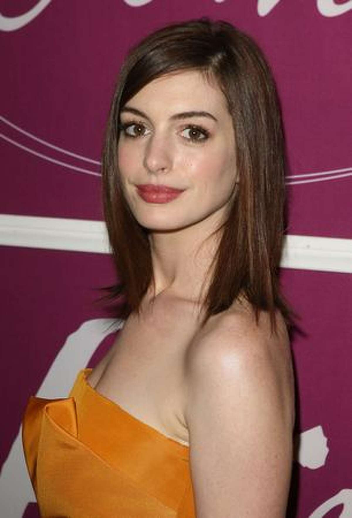 Actress Anne Hathaway arrives at Variety's 1st Annual Power of Women Luncheon at the Beverly Wilshire Hotel in Beverly Hills, California.