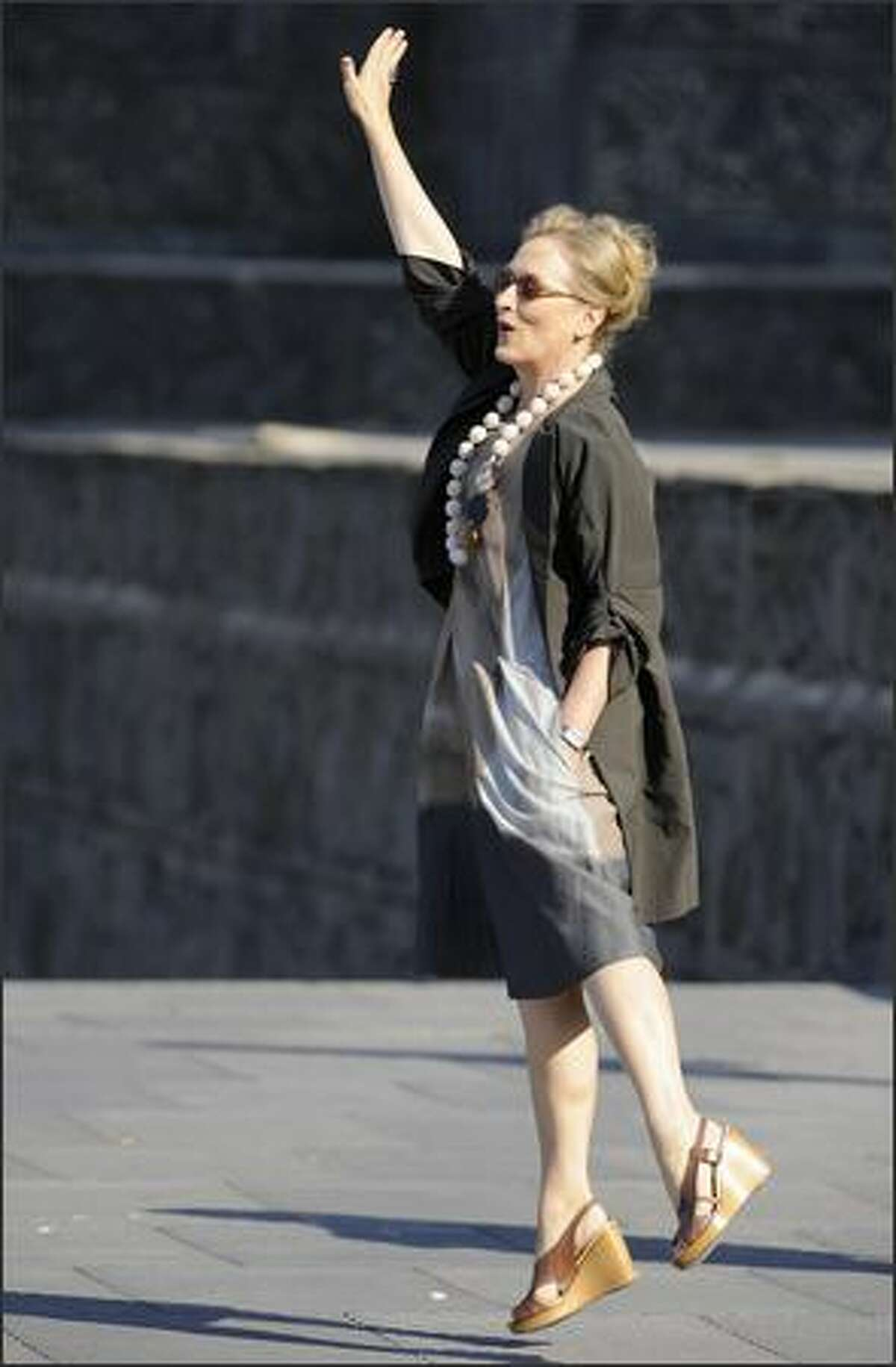 Actress Meryl Streep waves during a photocall in the 56th San Sebastian International Film Festival.