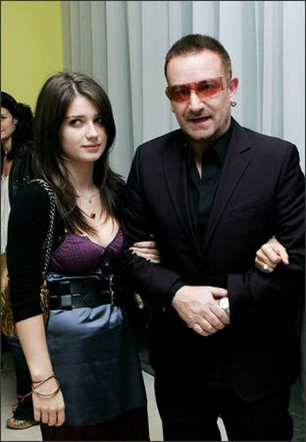 U2 frontman Bono and his guest arrive at the afterparty following