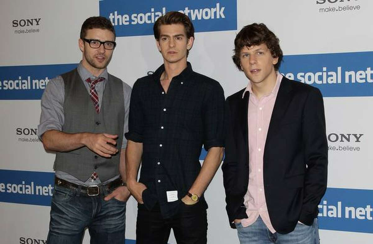(L-R) Actors Justin Timberlake, Andrew Garfield and Jesse Eisenberg attend a photocall to promote the film 'The Social Network' at Hotel Adlon on Tuesday in Berlin, Germany.