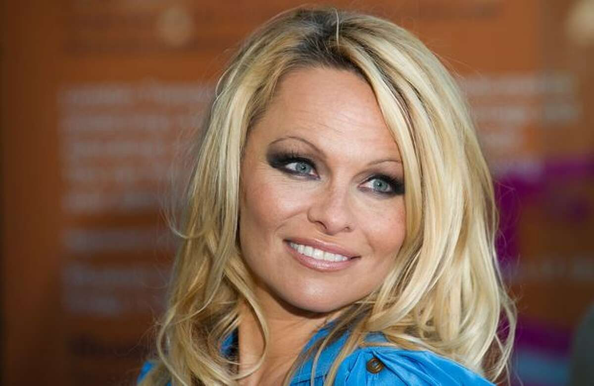 Actress Pamela Anderson poses during the unveiling of a new People for the Ethical Treatment of Animals (PETA) poster in Covent Garden, central London.
