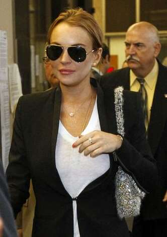 Actress Lindsay Lohan arrives at court in Beverly Hills, California on October 22, 2010 for a formal hearing to determine if she violated her probation in a pair of driving under the influence cases by failing a court-ordered drug test last month. The 24-year-old actress was initially ordered jailed for 30 days without bail on September 24, 2010 by Beverly Hills Superior Court Judge Elden Fox. However, she was released from jail hours later after another judge ruled that Lohan should be allowed to post a three thousand dollar bond. Lohan has been at the Betty Ford Center in Rancho Mirage since shortly after that. Photo: Getty Images / Getty Images