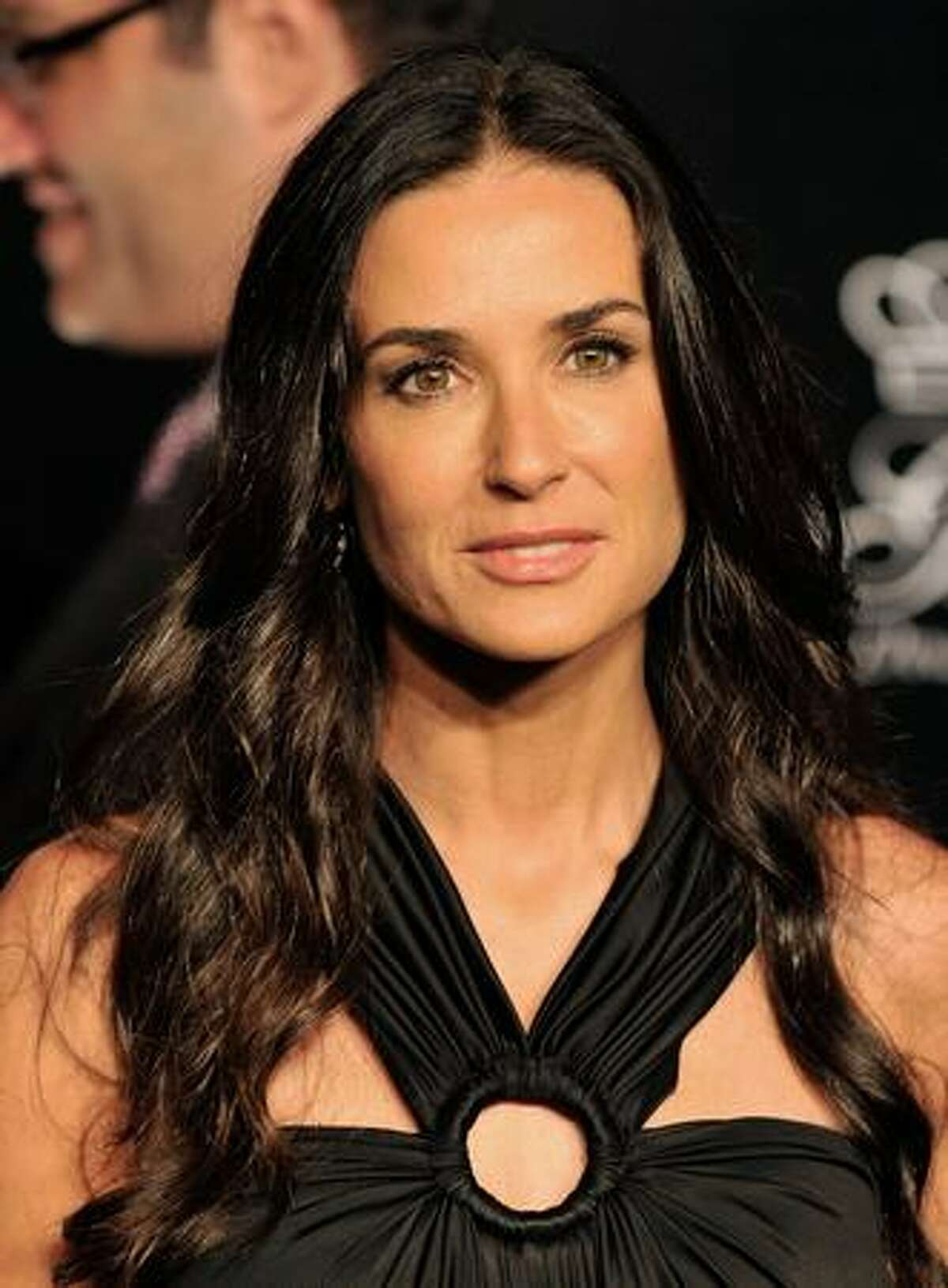 Actress Demi Moore arrives at the Rodeo Drive Walk of Style Award honoring Princess Grace (Kelly) of Monaco and Cartier in Beverly Hills, California.
