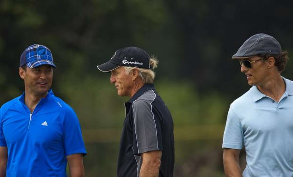 Hong Kong actor Michael Wong, golfer Greg Norman of Australia and Actor Mathew McConaughey in action during day five of the Mission Hills Start Trophy tournament at Mission Hills Resort in Haikou, China.