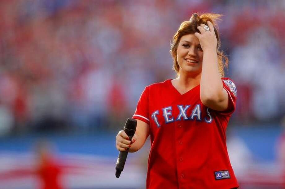 Singer Kelly CLarkson performs the National Anthem prior to the Texas Rangers playing against the San Francisco Giants in Game Three of the 2010 MLB World Series at Rangers Ballpark in Arlington, Texas. Photo: Getty Images / Getty Images