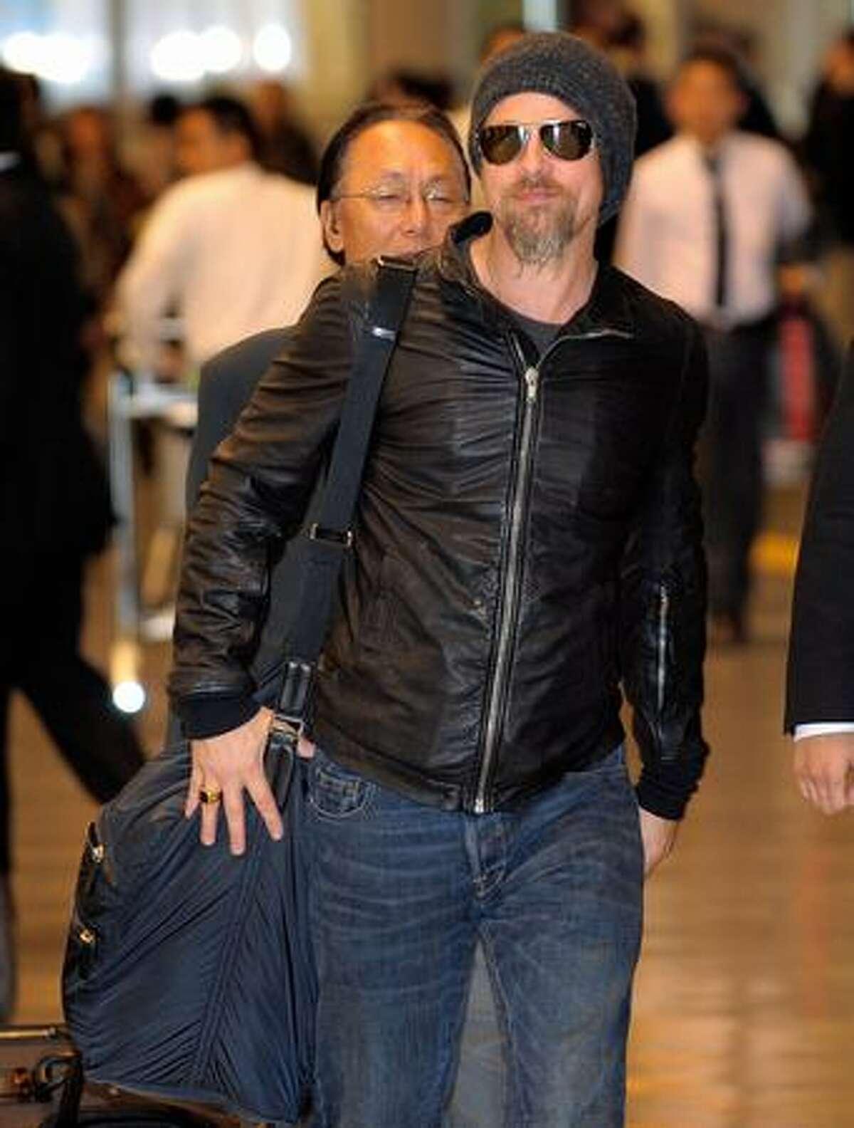 Brad Pitt arrives at Narita International airport Tuesday in the eastern surburbs of Tokyo. AFP PHOTO / TOSHIFUMI KITAMURA