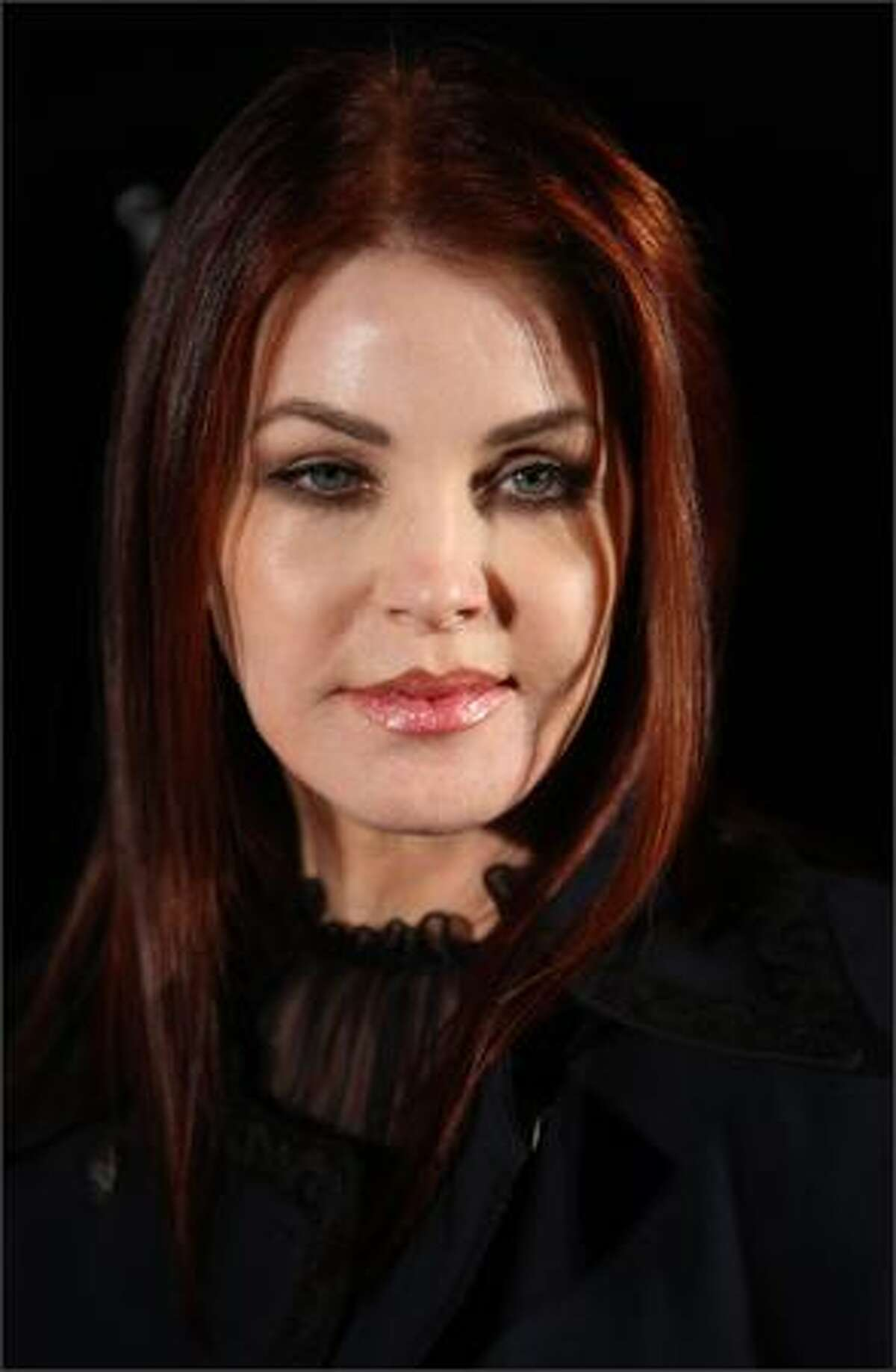 Actress Priscilla Presley arrives at the opening of