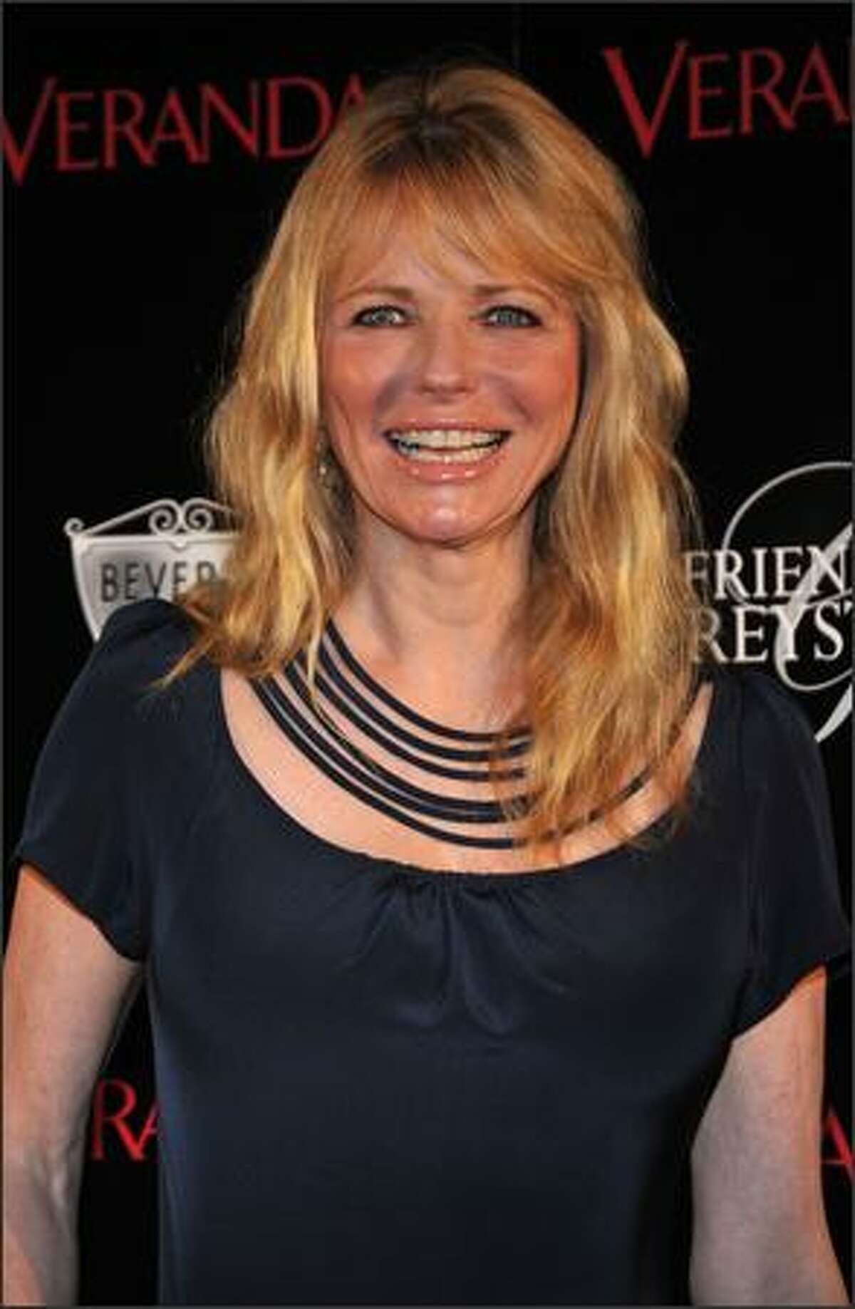Actress Cheryl Tiegs arrives at the opening of