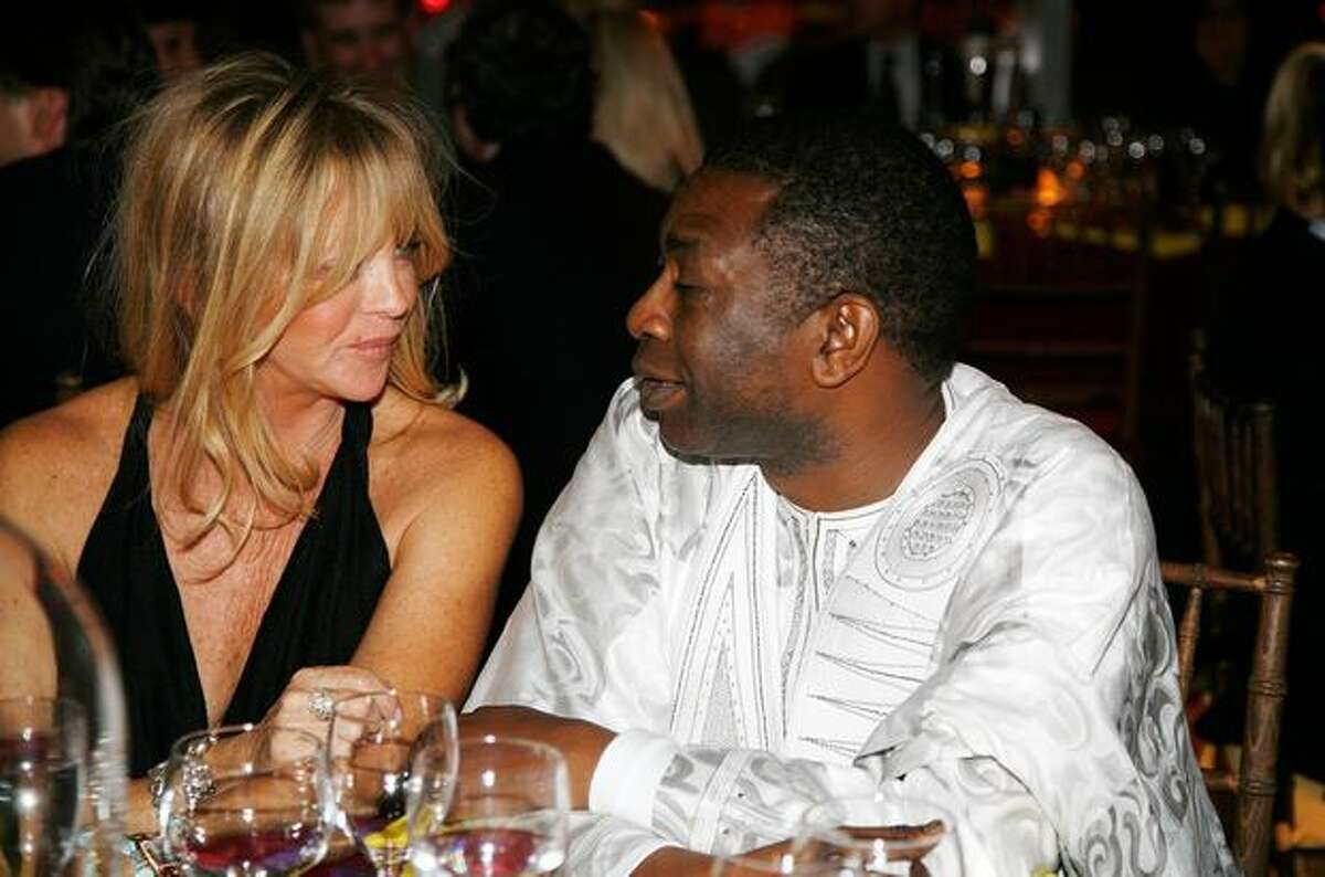 Actress Goldie Hawn and honoree Youssou NDour talk at the 2010 Malaria No More Benefit at The IAC Building in New York City.