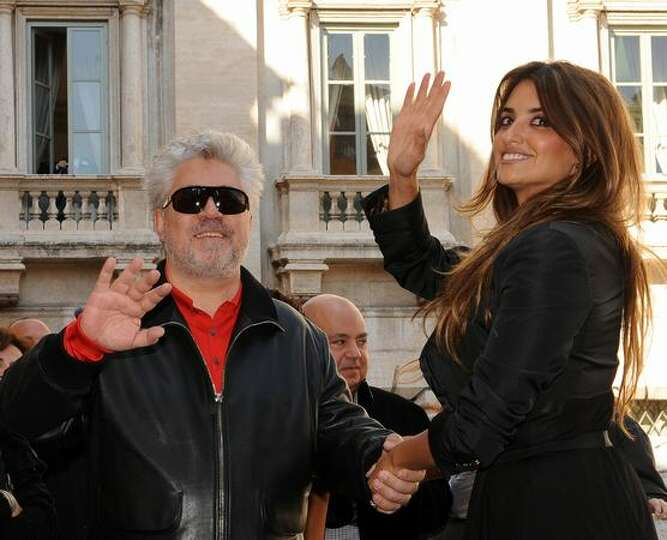 Spanish actress Penelope Cruz (R) and Spanish film director Pedro Almodovar pose at the Fontana Di T