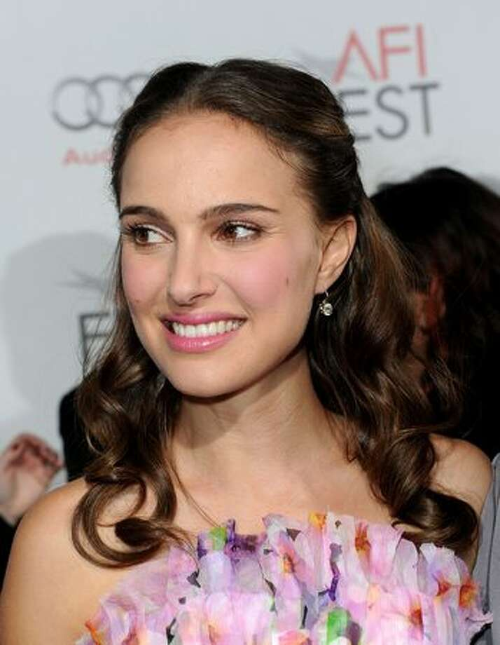 "Actress Natalie Portman arrives at the ""Black Swan"" closing night gala during AFI FEST 2010 presented by Audi held at Grauman's Chinese Theatre in Hollywood, California. Photo: Getty Images / Getty Images"