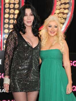Cher and actress/singer Christina Aguilera arrive at the premiere of Screen Gems' 'Burlesque' at Grauman's Chinese Theater in Los Angeles, California. Photo: Getty Images / Getty Images