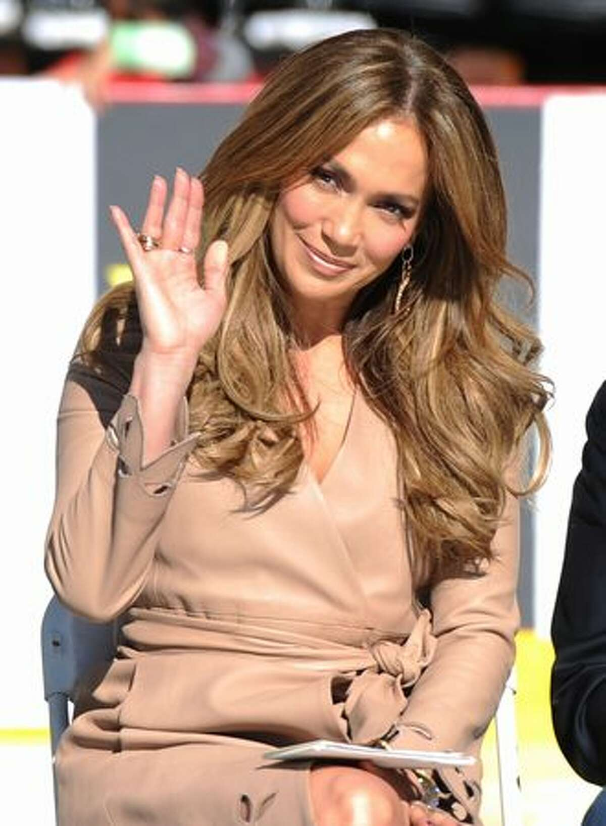 Actress Jennifer Lopez poses as Denzel Washington announces Jennifer Lopez as a national spokesperson for The Boys & Girls Club Of America in Los Angeles, California.