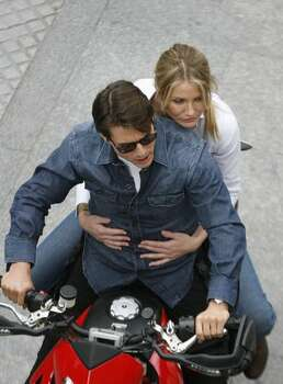 "Actors Tom Cruise and Cameron Diaz ride a motorbike on the set during the filming of ""Knight & Day"", a movie being directed by director James Mangold in Cadiz, Spain. Photo: Getty Images / Getty Images"