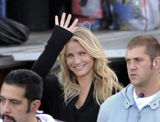 "Actress Cameron Diaz is surrounded by security guards at the Santa Justa Train station on the set of ""Knight & Day"", a movie directed by U.S. director James Mangold in Seville, Spain. Photo: Getty Images / Getty Images"