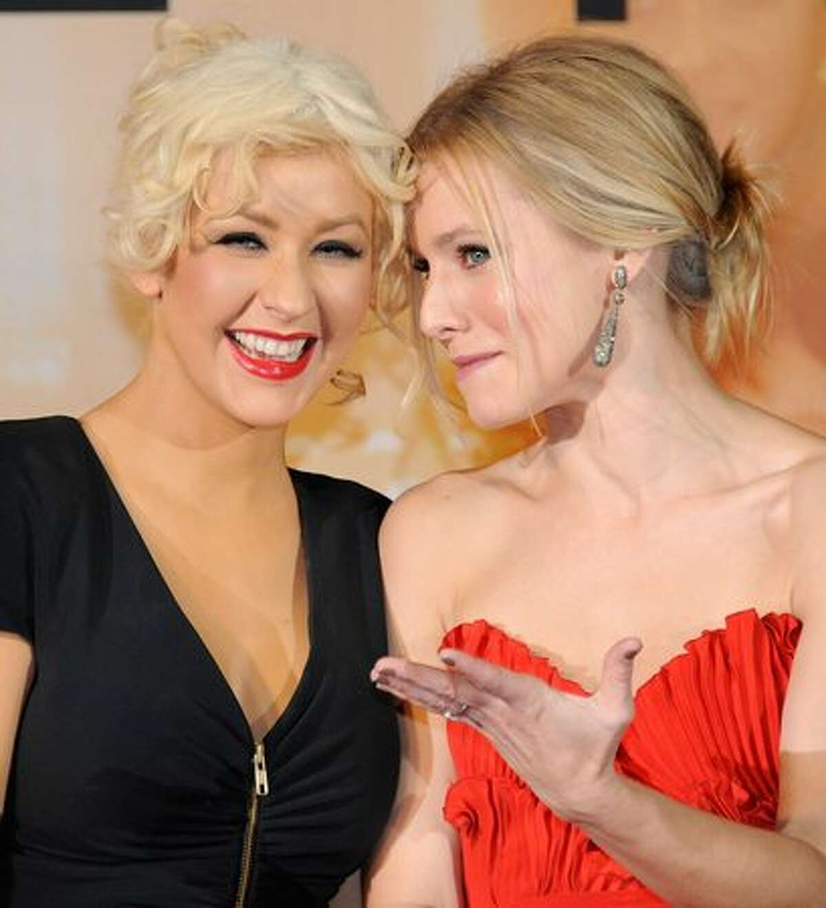 Actress Christina Aguilera (L) shares a light moment with Kristen Bell (R) during the Japan premier of their film