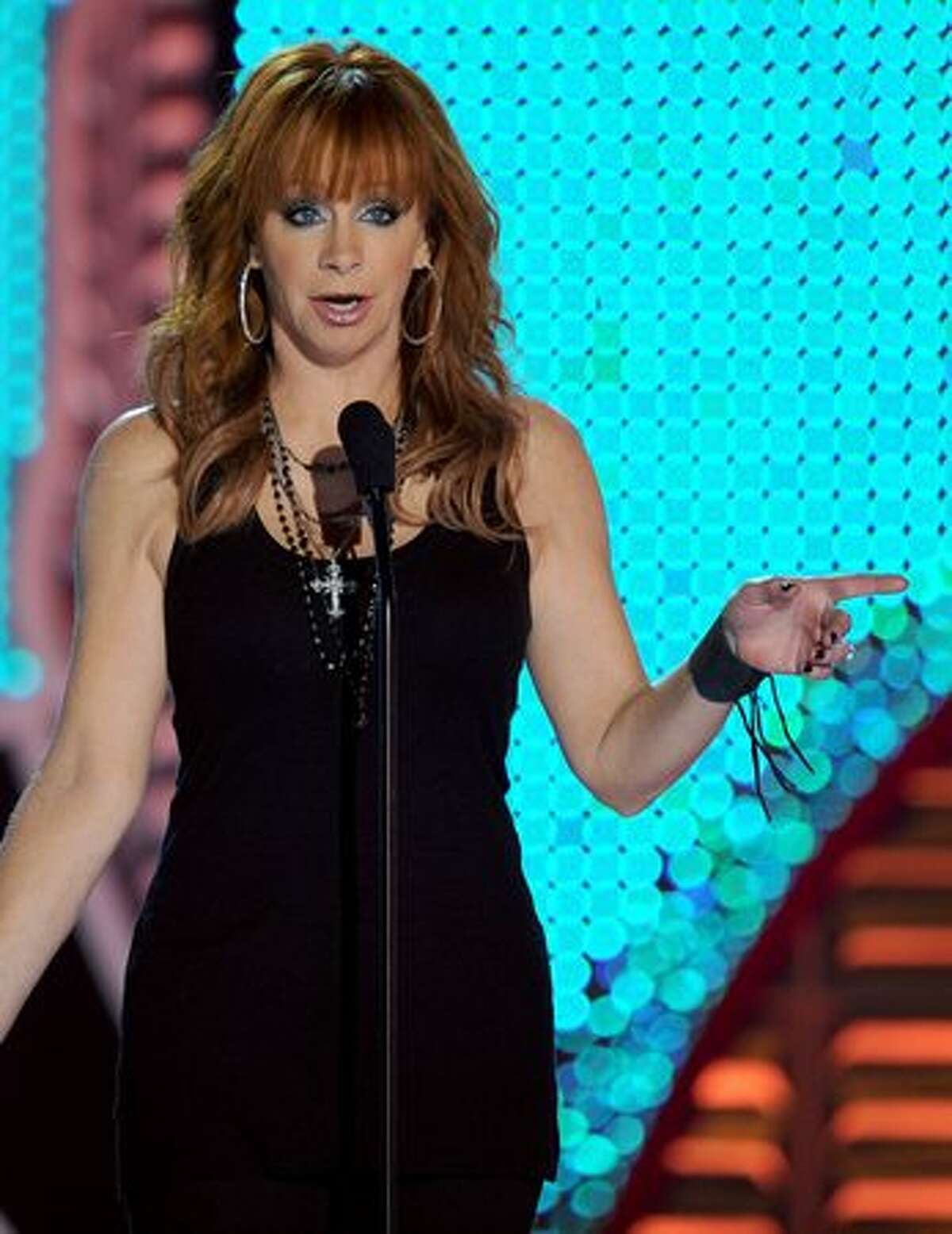 Singer Reba McEntire speaks onstage during the American Country Awards 2010 held at the MGM Grand Garden Arena in Las Vegas, Nevada.
