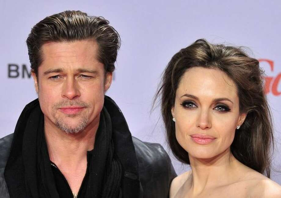 "US actor Brad Pitt and actress Angelina Jolie pose for photographers as they arrive for the European premiere of the film ""The Tourist"", by German director Florian Henckel von Donnersmarck, in Berlin Tuesday. Photo: Getty Images / Getty Images"
