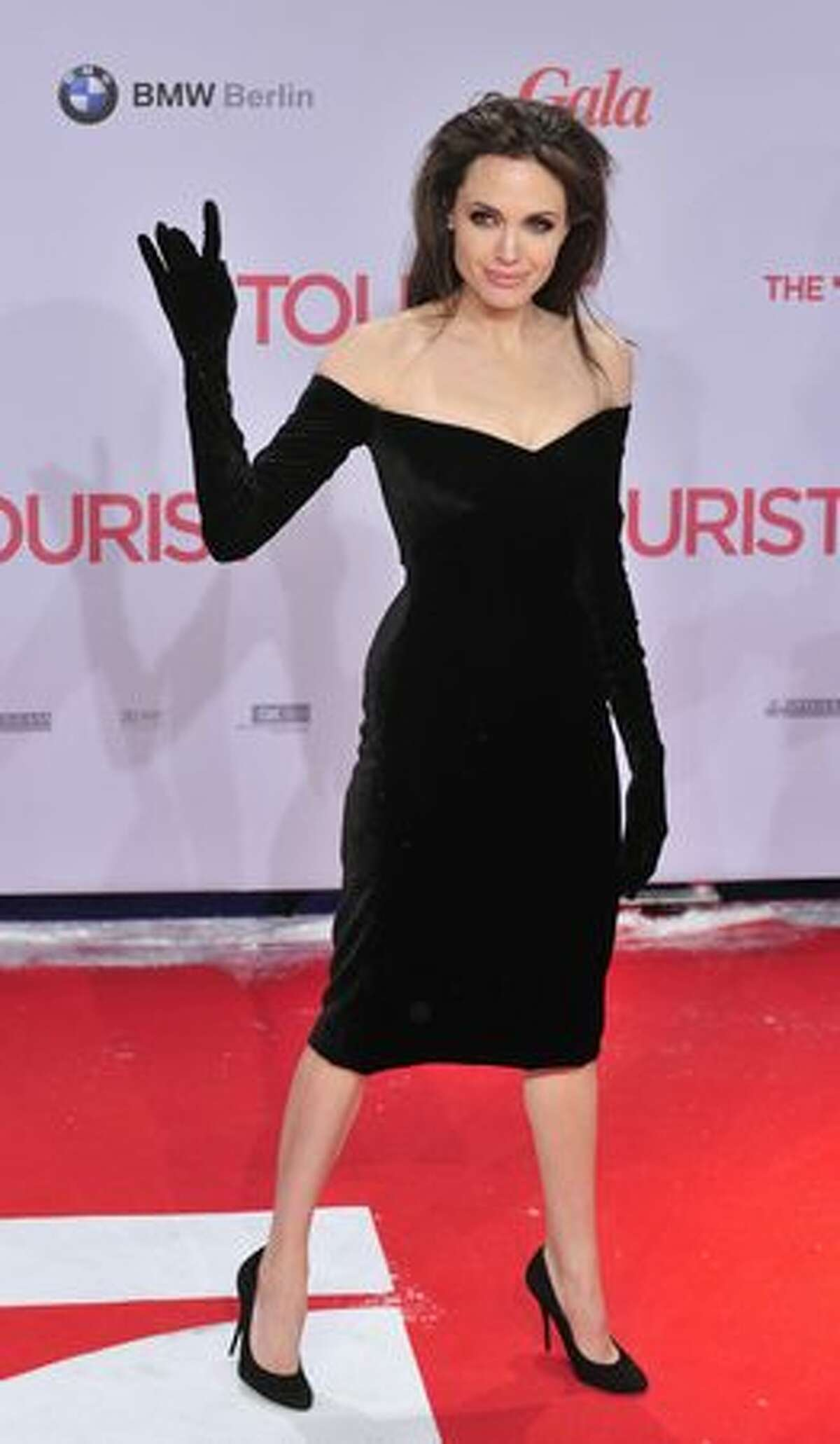 US actress Angelina Jolie waves as she arrives for the European premiere of The Tourist, by German director Florian Henckel von Donnersmarck, in Berlin Tuesday.