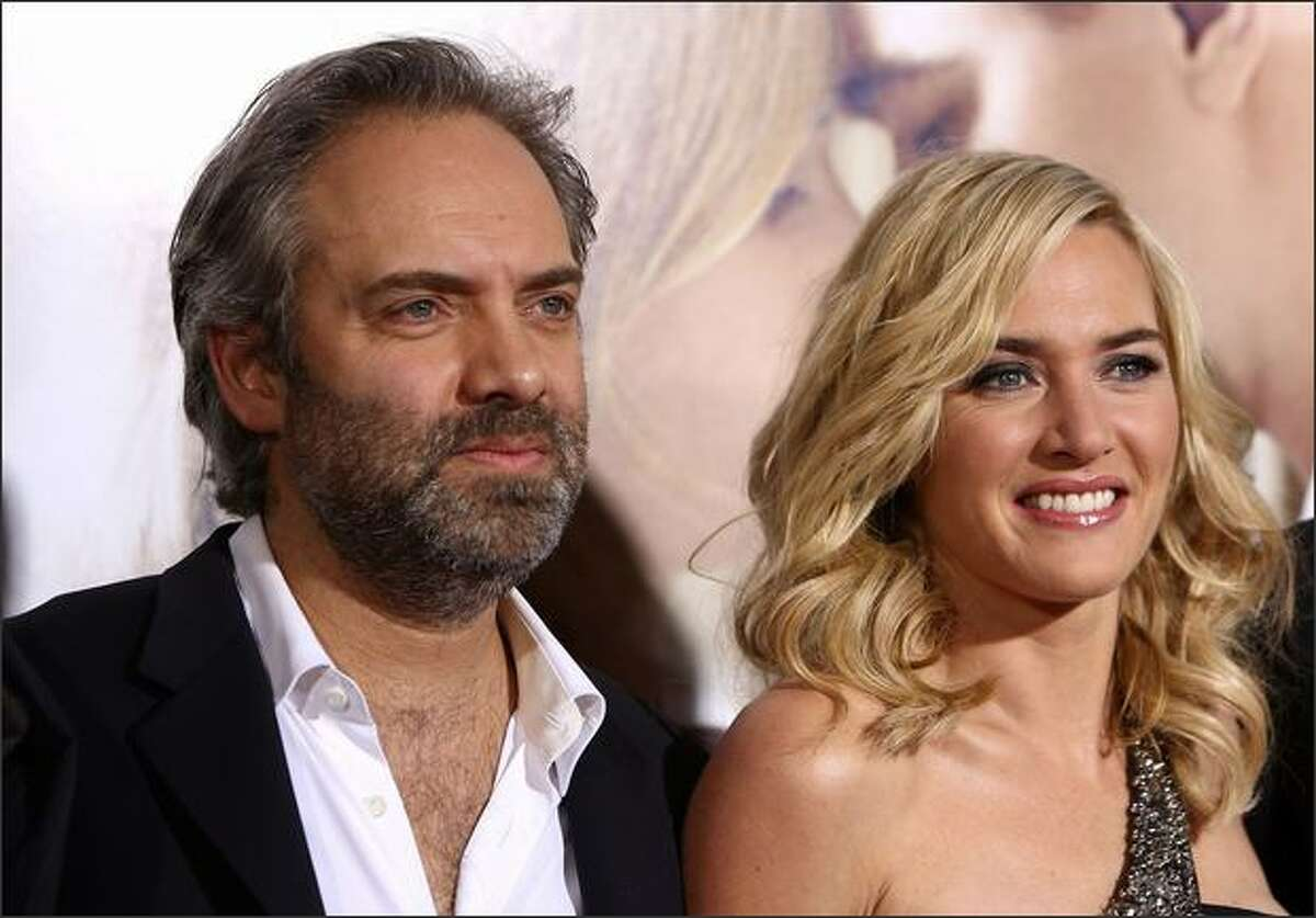 Director Sam Mendes and actress Kate Winslet arrive at Paramount Vantage's Los Angeles premiere of 'Revolutionary Road' held at Mann Village Theater in Westwood, California.