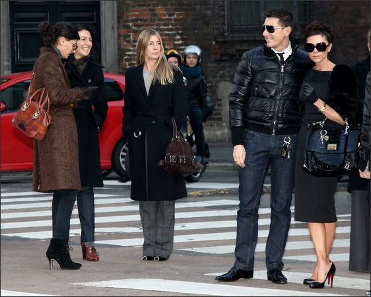 (L-R) Stefano Gabbana and Victoria Beckham are seen December 21, 2008 in Milan, Italy.