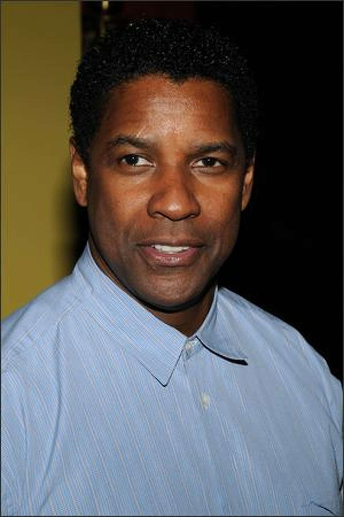 Actor Denzel Washington arrives at the premiere of