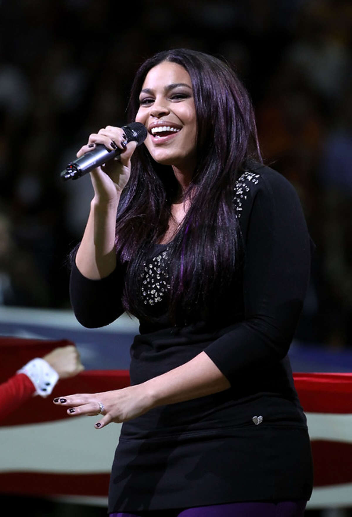 Singer Jordin Sparks performs the National Anthem before the NBA game between the Miami Heat and the Phoenix Suns at US Airways Center in Phoenix, Arizona.
