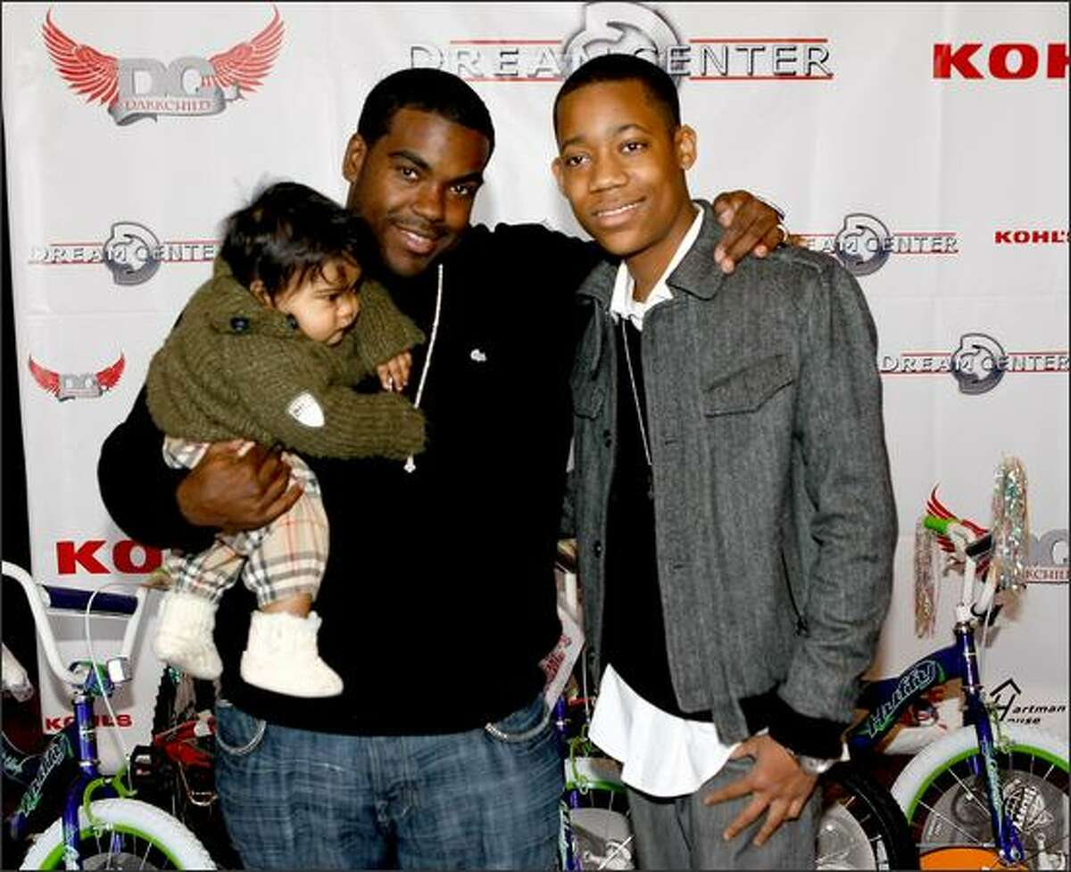 Producer Rodney Jerkins (L) and actor Tyler James Williams attend the 14th Annual Christmas In The City Giveaway at the Galen Center in Los Angeles, California.