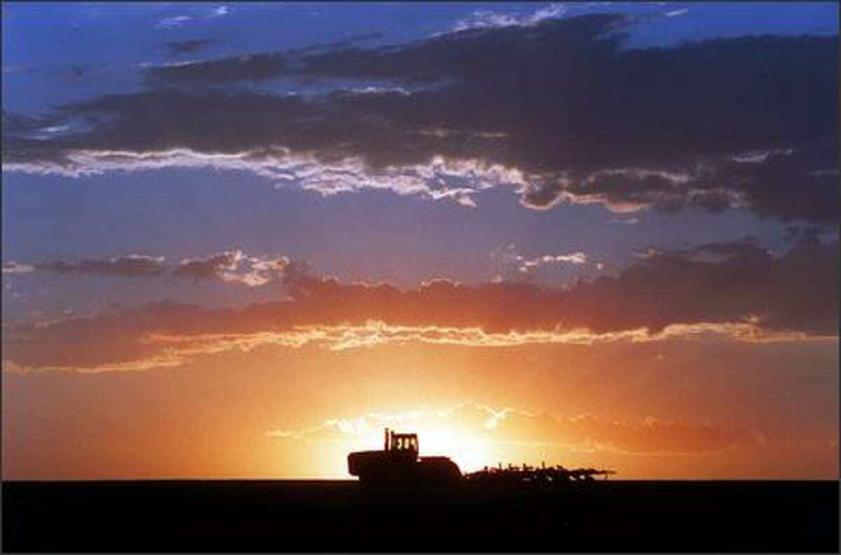 Beautiful scenes in Eastern Washington such as this sunset over a wheat field keep a photographer returning.