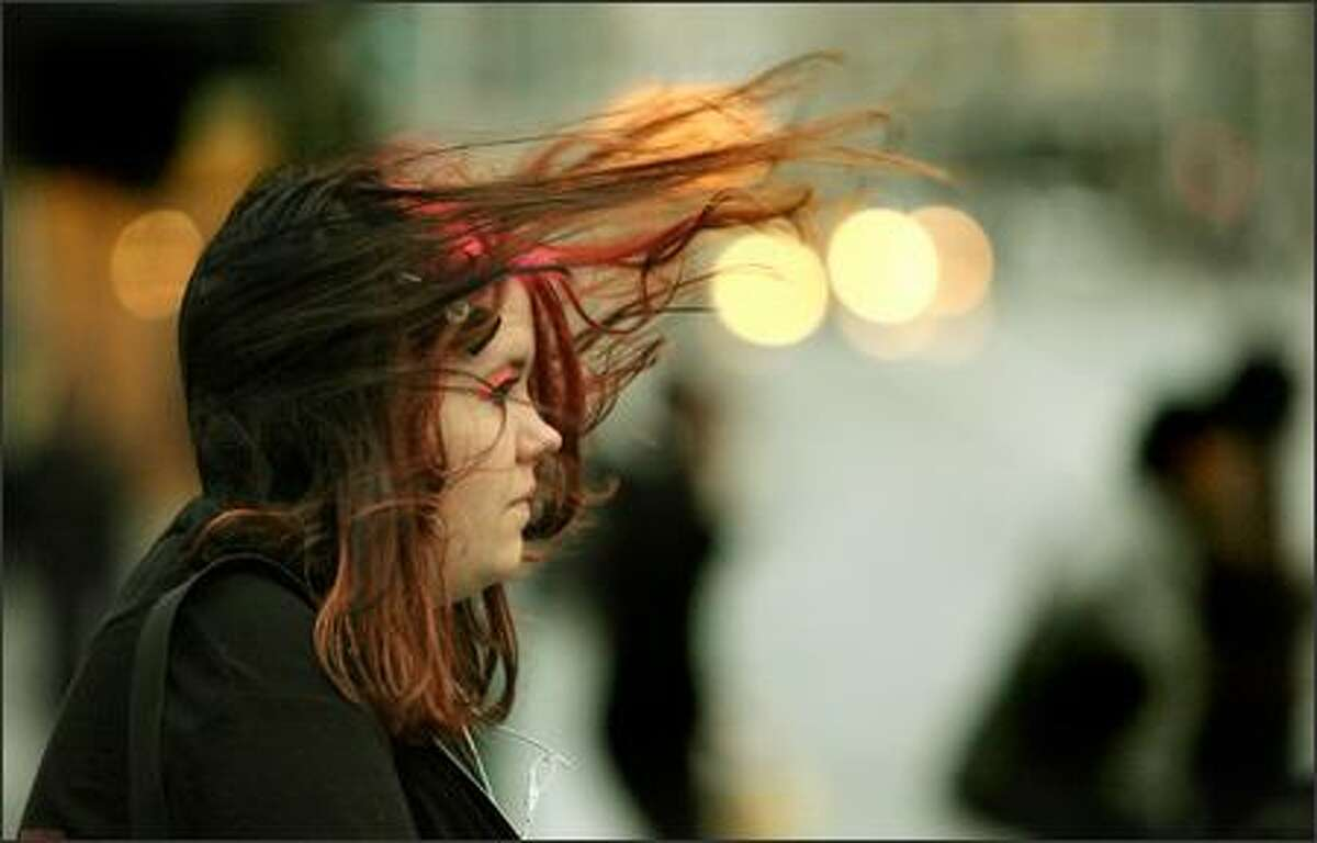 A gust of wind sends 15-year-old Lelio Solowoniuk's hair flying Tuesday as she waits to cross Second Avenue in downtown Seattle.