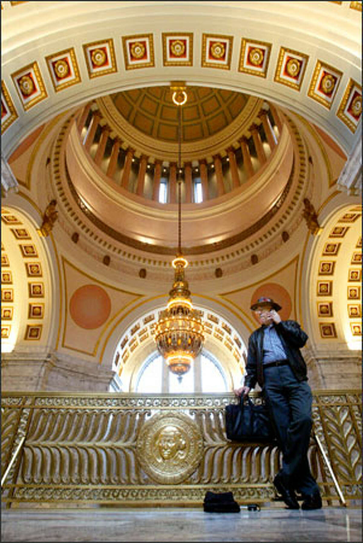 Bob Higley of Olympia, a lobbyist with the Faith and Freedom Network, makes a call Tuesday from the state Capitol in anticipation of the start Monday of the 60-day legislative session.