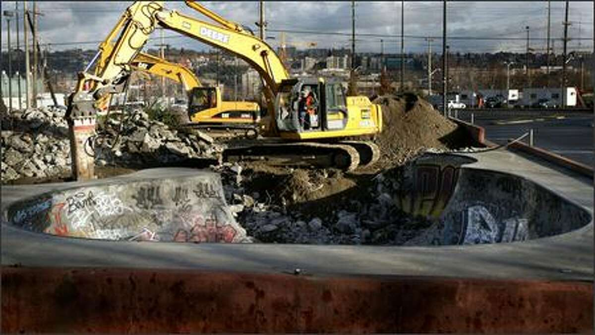 Workers demolish the Seattle Center SkatePark on Wednesday. The site will hold a parking garage and the new headquarters of the Bill & Melinda Gates Foundation. As part of the deal to buy the land, the foundation provided nearly $1 million for a new skate park.