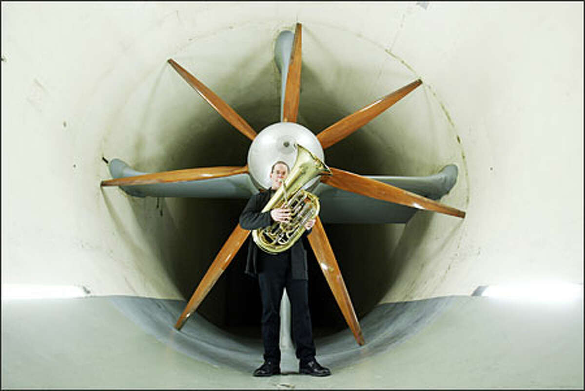 Seattle Symphony principal tuba player Christopher Olka stands in the F.K. Kirsten Wind Tunnel where the late Boeing engineer -- and tuba player -- James Crowder once worked. Samuel Jones, whose concerto was commissioned in Crowder's memory, wants to replicate the tunnel's