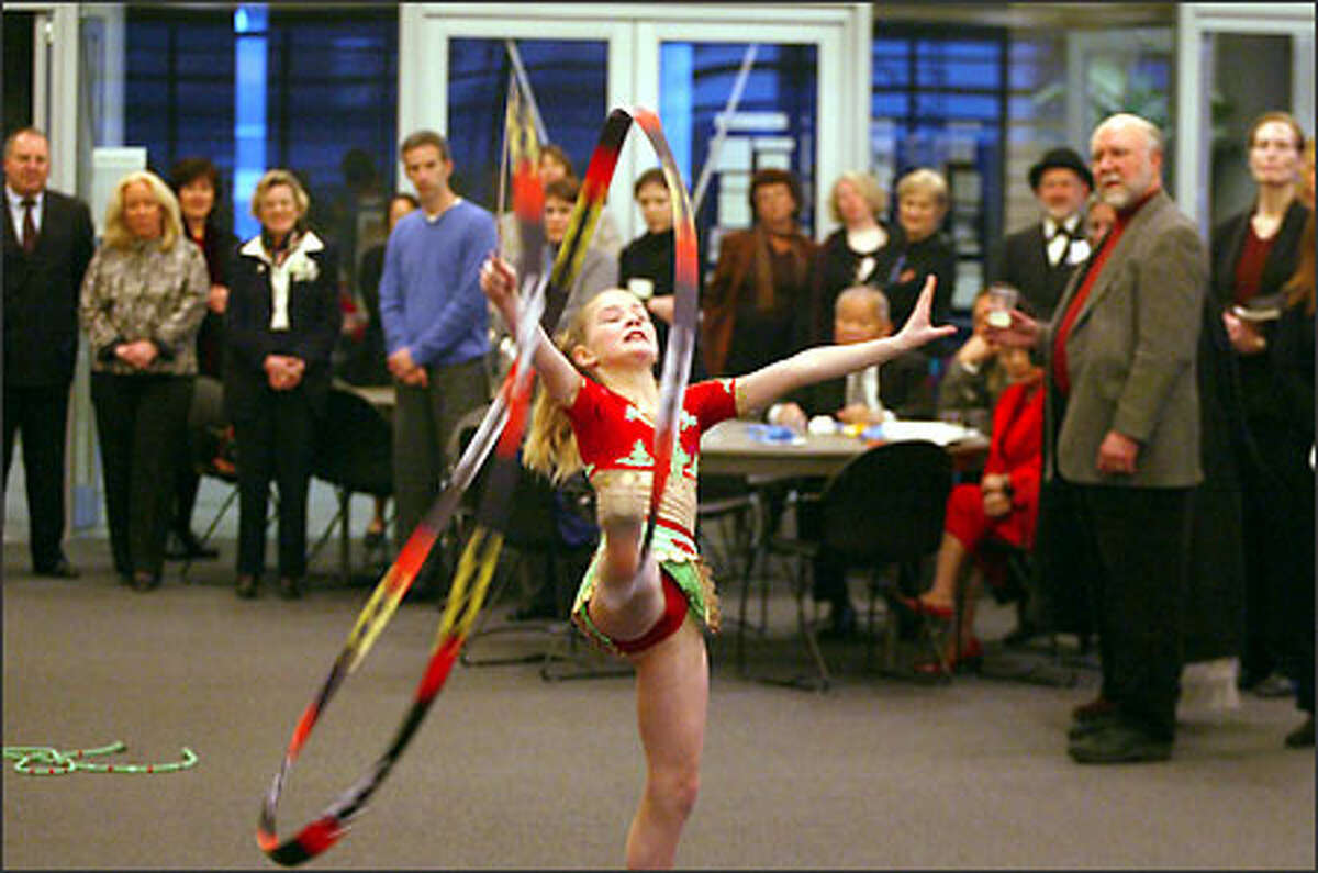 After the City Council inauguration, Katya Furlong, 9, of the Seattle Tashkent Sister Cities Association, performs a gymnastics routine at a reception in the new City Hall.