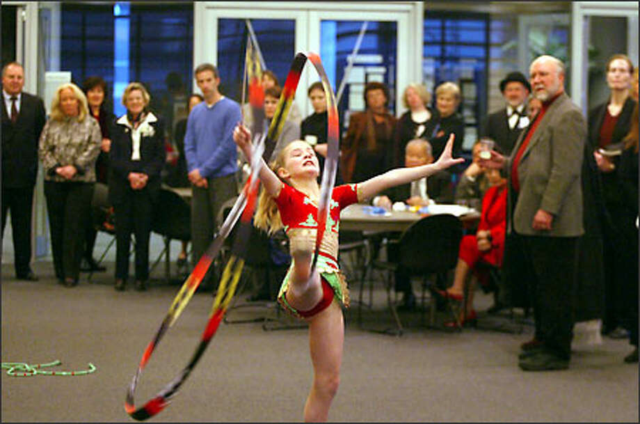 After the City Council inauguration, Katya Furlong, 9, of the Seattle Tashkent Sister Cities Association, performs a gymnastics routine at a reception in the new City Hall. Photo: Grant M. Haller, Seattle Post-Intelligencer / Seattle Post-Intelligencer