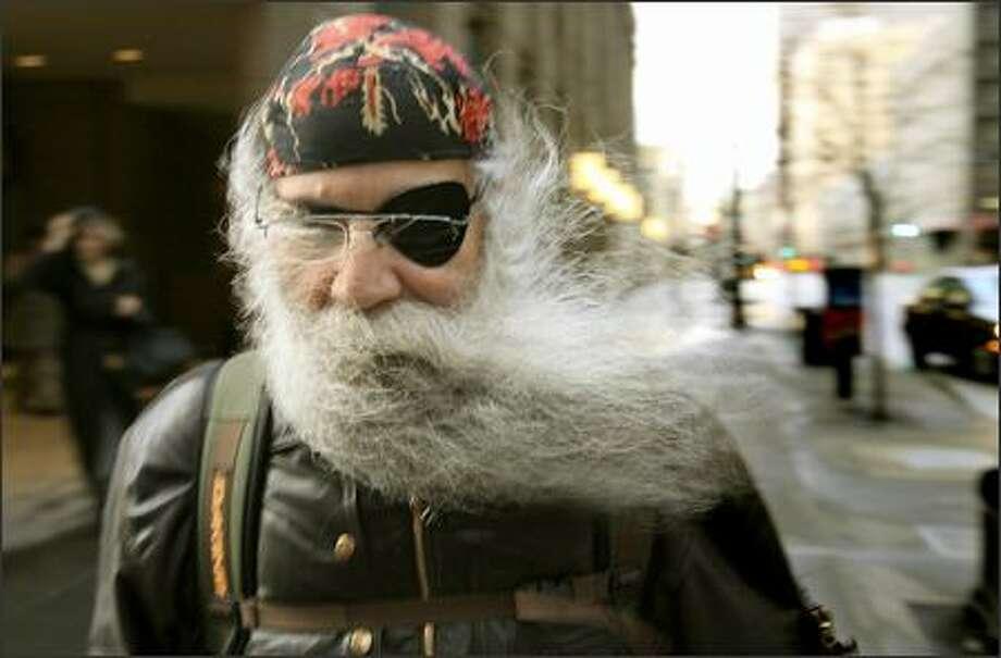 A strong gust of wind sends Frank Zamfino's beard flying as he walks along Third Avenue in downtown Seattle. Photo: Dan DeLong, Seattle Post-Intelligencer / Seattle Post-Intelligencer
