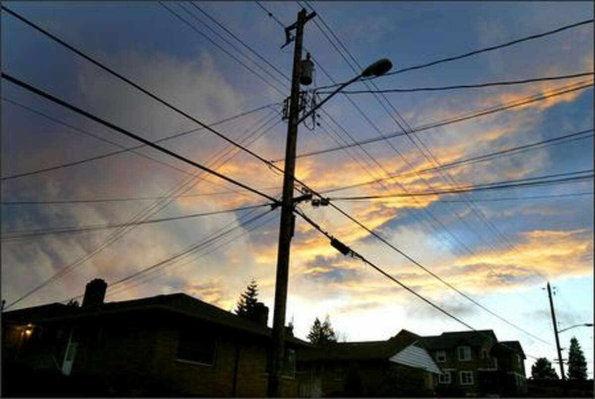 Dark clouds loom over a Ballard neighborhood and its power lines.